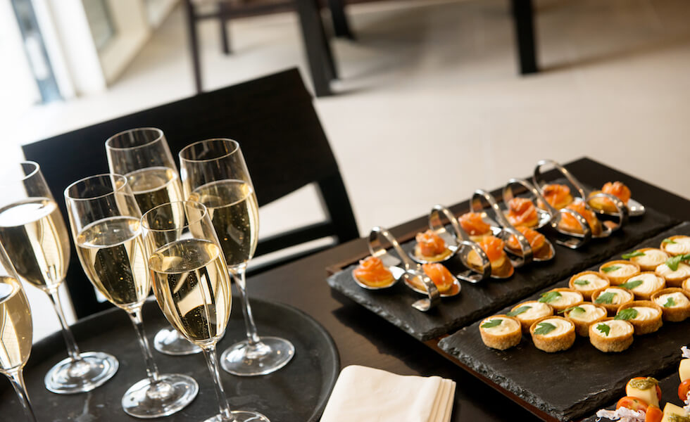 Champagne And Appetizers On A Black Table
